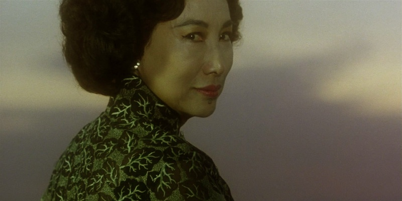 《阿飞正传》截图,潘迪华饰演旭仔的养母